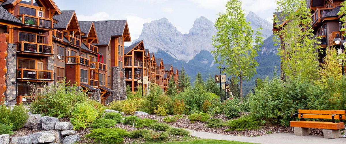 Summer or fall view of Origin at Spring Creek building with Three Sisters Mountains in the background