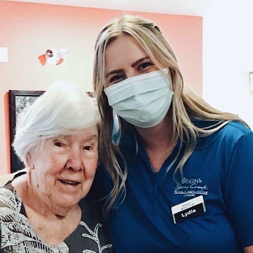 Life Enrichment Companion Lydia at Origin at Spring Creek with female senior resident